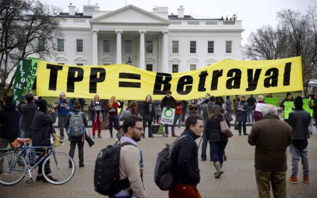 WASHINGTON, DC - FEBRUARY 03: Activists hold a rally to protest the Trans-Pacific Partnership (TPP) in front of the White house on February 3, 2016 in Washington, DC. The TPP trade pact is expected to be signed in New Zealand on February 4. (Photo by Olivier Douliery/Getty Images)
