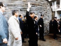 President Ronald Reagan Waves To Onlookers Moments Before An Assassination Attempt By John Hinckley Jr March 30, 1981 By The Washington Hilton In Washington Dc.James Brady Is Visible Third From The Left.