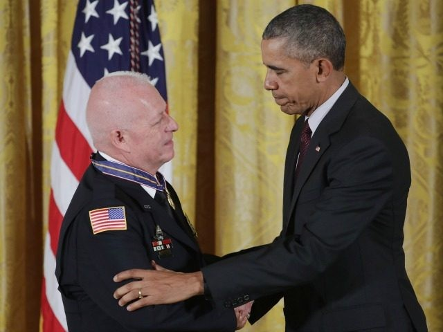 President Barack Obama awards Garland Police Officer Gregory Stevens with the 2014-2015 Public Safety Office Medal of Valor during a ceremony in the East Room of the White House May 16, 2016 in Washington, DC.