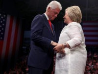 BROOKLYN, NY - JUNE 07: Democratic presidential candidate former Secretary of State Hillary Clinton (R) and her husband former U.S. president Bill Clinton embrace during a primary night event on June 7, 2016 in Brooklyn, New York. Hillary Clinton surpassed the number of delegates needed to become the democratic nominee …