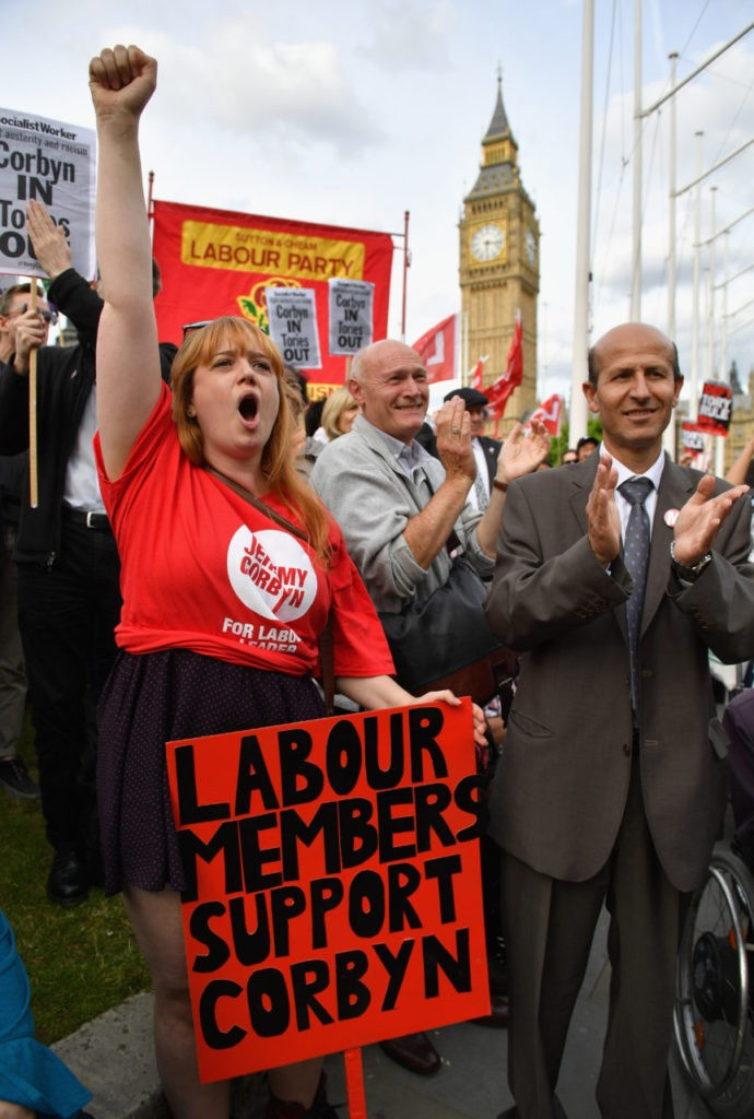 LONDON, ENGLAND - JUNE 27: Supporters of Labour leader Jeremy Corbyn shout and clap during Momentum's 'Keep Corbyn' rally outside the Houses of Parliament on June 27, 2016 in London, England. The Labour Leader has seen mass resignations from the Shadow Cabinet in the wake of the UK Vote for Brexit. His support group, Momentum, have recorded more than 1000 new members in the same period. (Photo by Jeff J Mitchell/Getty Images)
