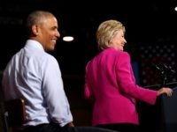 Democratic presidential candidate former Secretary of State Hillary Clinton and U.S. president Barack Obama look on during a campaign rally with on July 5, 2016 in Charlotte, North Carolina.