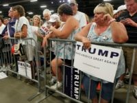 Campaign supporters wait to see Republican Presidential candidate Donald Trump before a campaign rally at the Sharonville Convention Center July 6, 2016, in Cincinnati