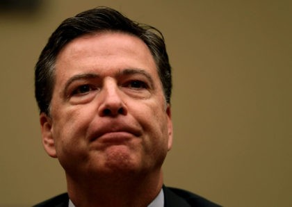 """WASHINGTON, DC - JULY 07: FBI Director James Comey testifies during a hearing before House Oversight and Government Reform Committee July 7, 2016 on Capitol Hill in Washington, DC. The committee held a hearing """"Oversight of the State Department,"""" focusing on the FBI's recommendation not to prosecute Democratic presidential candidate …"""