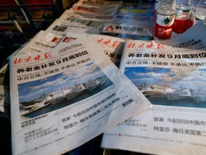 In this photo illustration, Beijing Evening newspaper headlines of the Chinese naval fleet exercises displayed in a newsagents shop on July 12, 2016 in Beijing, China.