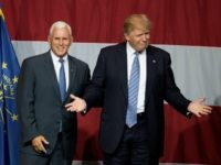 Republican presidential candidate Donald Trump (R) and Indiana Governor Mike Pence (L) take the stage during a campaign rally at Grant Park Event Center in Westfield, Indiana, on July 12, 2016. / AFP / Tasos KATOPODIS (Photo credit should read