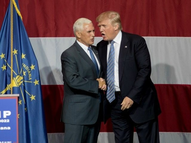 Republican presidential candidate Donald Trump greets Indiana Gov. Mike Pence at the Grand Park Events Center on July 12, 2016 in Westfield, Indiana. Trump is campaigning amid speculation he may select Indiana Gov. Mike Pence as his running mate. (Photo by