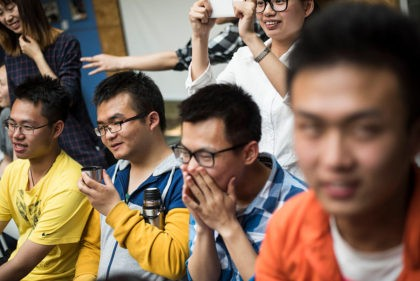 This photo taken on April 29, 2016 shows Chinese students having a laugh as they attend a course taught by Xie Shu (not pictured), a teacher at Tianjin University in the northeastern Chinese city of Tianjin. Xie's Theory and Practice of Romantic Relations course at Tianjin University includes lectures on …