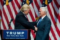 NEW YORK, NY - JULY 16: (L to R) Republican presidential candidate Donald Trump shakes hands with his newly selected vice presidential running mate Mike Pence, governor of Indiana, during an event at the Hilton Midtown Hotel, July 16, 2016 in New York City. On Friday, Trump announced on Twitter …