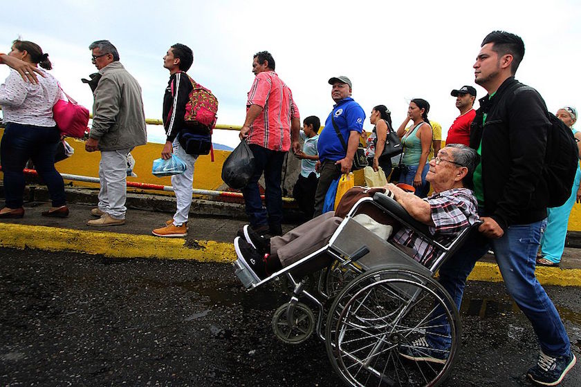 Venezuelans queue to cross the Simon Bolivar bridge linking San Antonio del Tachira, in Venezuela with Cucuta, Colombia in order to buy supplies, on July 16, 2016. Thousands of Venezuelans crossed into the Colombian city of Cucuta to buy food and medicine, taking advantage of another brief opening in the border that's been closed nearly a year. Caracas authorized the temporary opening a week after some 35,000 Venezuelans poured across the border during a 12-hour opening of the pedestrian bridge. / AFP / GEORGE CASTELLANOS (Photo credit should read GEORGE CASTELLANOS/AFP/Getty Images)