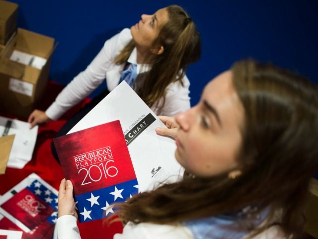Volunteers organise pamphlets outlining the Republican party platform before the opening of the Republican National Convention on July 18, 2016 in Cleveland, Ohio