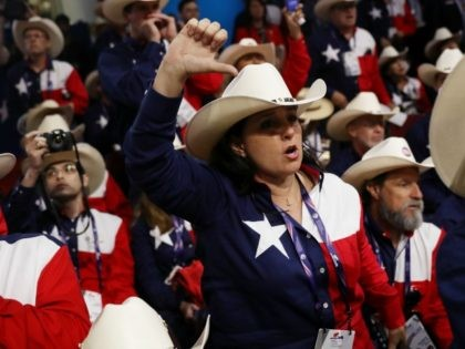 Delegates from Texas oppose a roll call vote on the floor during on the first day of the Republican National Convention on July 18, 2016 at the Quicken Loans Arena in Cleveland, Ohio. An estimated 50,000 people are expected in Cleveland, including hundreds of protesters and members of the media. …