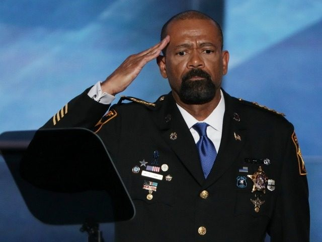 Milwaukee County Sheriff David Clarke salutes the crowd prior to delivering a speech on the first day of the Republican National Convention on July 18, 2016 at the Quicken Loans Arena in Cleveland, Ohio. An estimated 50,000 people are expected in Cleveland, including hundreds of protesters and members of the …