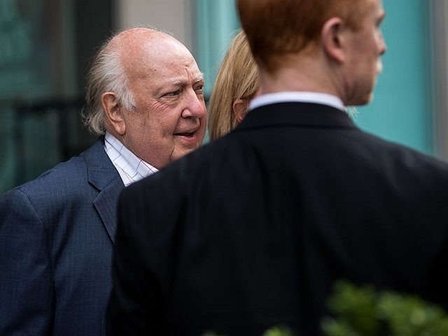 NEW YORK, NY - JULY 19: Security stands in front of Fox News chairman Roger Ailes as he leaves the News Corp building, July 19, 2016 in New York City. As of late Tuesday afternoon, Ailes and 21st Century Fox are reportedly in discussions concerning his departure from his position …