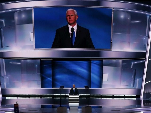 Republican Vice Presidential candidate Mike Pence acknowledges the crowd after delivering a speech on the third day of the Republican National Convention on July 20, 2016 at the Quicken Loans Arena in Cleveland, Ohio.
