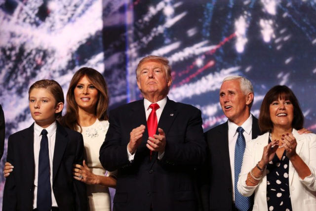 CLEVELAND, OH - JULY 21: (L-R) Barron Trump, Melania Trump, Republican presidential candidate Donald Trump, Republican vice presidential candidate Mike Pence and Karen Pence acknowledge the crowd at the end of the the Republican National Convention on July 21, 2016 at the Quicken Loans Arena in Cleveland, Ohio. Republican presidential …