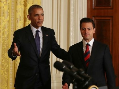 President Barak Obama (L) and Mexican President Enrique Pena Nieto arrive to speak to the media during a news conference in the East Room at the White House July 22, 2016 in Washington, DC.