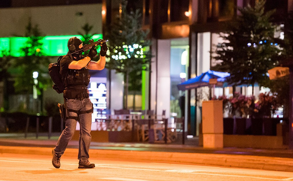 A policeman secures the area around the shopping mall Olympia Einkaufzentrum OEZ in Munich on July 22, 2016 after gunmen went on a shooting rampage in the busy shopping centre, killing eight people in a suspected terror attack. The southern city was in lockdown after the shootings, which saw panicked shoppers fleeing the Olympia mall as armed anti-terror police roamed the streets in search of the assailants. / AFP / STRINGER (Photo credit should read STRINGER/AFP/Getty Images)