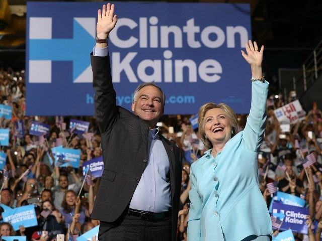 Democratic presidential candidate former Secretary of State Hillary Clinton and Democratic vice presidential candidate U.S. Sen. Tim Kaine (D-VA) greet supporters during a campaign rally at Florida International University Panther Arena on July 23, 2016 in Miami, Florida.