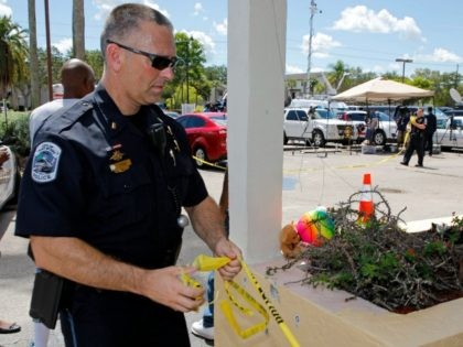 FORT MYERS, FL - JULY 25: Police remove the crime scene tape after finishing their investigation of the shooting outside of Club Blu where two people were killed and at least 15 wounded on July 25, 2016 in Fort Myers, Florida. (Photo by