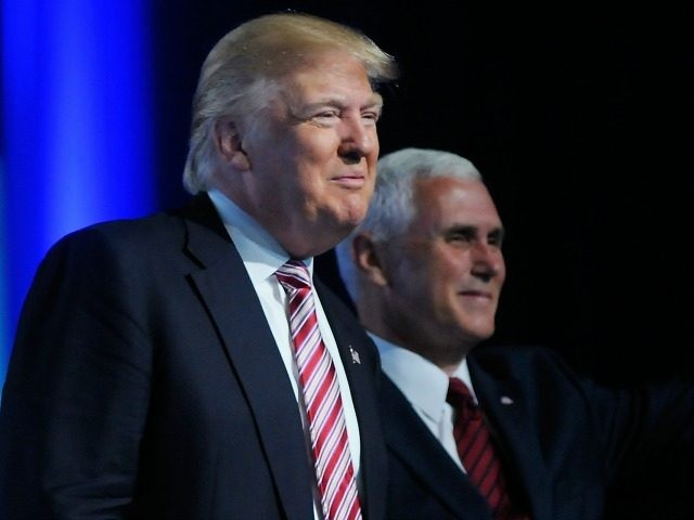 Republican presidential candidate Donald Trump (L) and Republican vice presidential candidate Mike Pence are introduced at the 117th National Convention of the Veterans of Foreign Wars of the United States at the Charlotte Convention Center on July 26, 2016 in Charlotte, North Carolina. One day after Democrat presidential candidate Hillary …