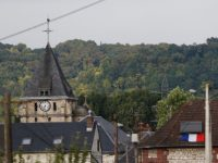 This photo taken on July 26, 2016 shows the steeple of the Saint-Etienne church of Saint-Etienne-du-Rouvray, where a priest was killed earlier today in the latest of a string of attacks against Western targets claimed by or blamed on the Islamic State jihadist group. French President Francois Hollande said that …