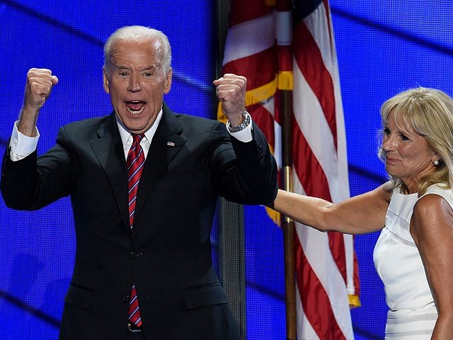 US Vice President Joe Biden and his wife Dr. Jill Biden exit the stage following the Vice President's address on the third evening session of the Democratic National Convention at the Wells Fargo Center in Philadelphia, Pennsylvania, July 27, 2016. / AFP / SAUL LOEB (Photo credit should read SAUL …