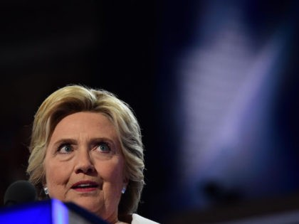 Democratic presidential nominee Hillary Clinton addresses delegates on the fourth and final night of the Democratic National Convention at Wells Fargo Center on July 28, 2016 in Philadelphia, Pennsylvania. / AFP / Robyn BECK (Photo credit should read ROBYN BECK/AFP/Getty Images)