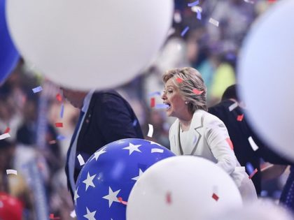 Balloons descend as Democratic presidential nominee Hillary Clinton celebrates on the fourth and final night of the Democratic National Convention at Wells Fargo Center on July 28, 2016 in Philadelphia, Pennsylvania. / AFP / Nicholas Kamm (Photo credit should read NICHOLAS KAMM/AFP/Getty Images)