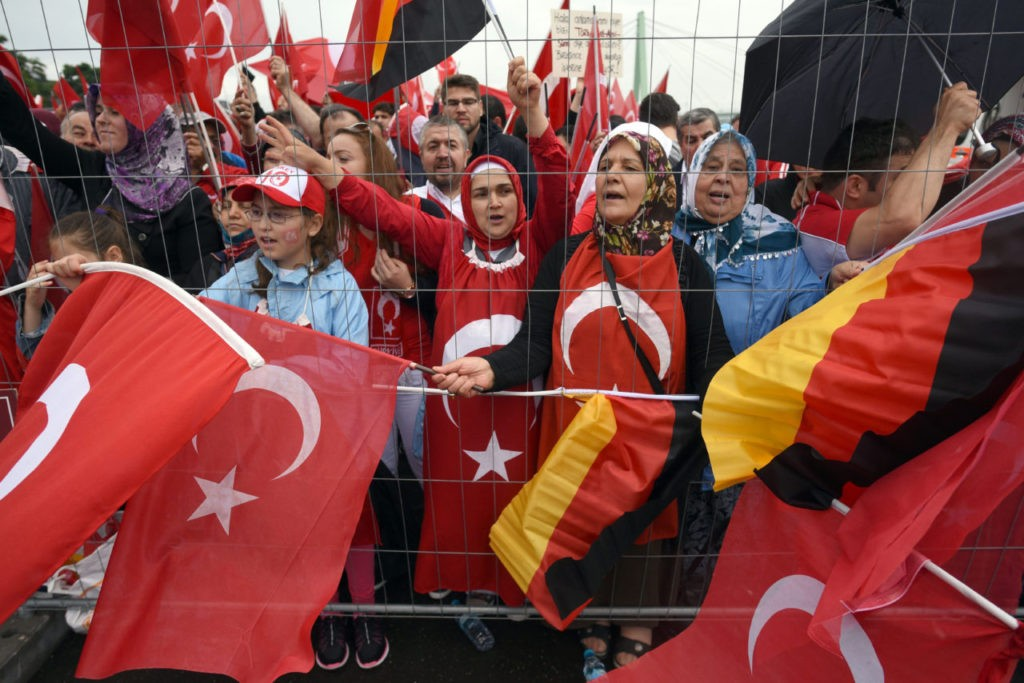 Supporters of Turkish President Recep Tayyip Erdogan attend a rally with German and Turkish flags on July 31, 2016 in Cologne, as tensions over Turkey's failed coup put authorities on edge. Police said some 20,000 people had joined in the demonstration staged by groups including the pro-Erdogan Union of European-Turkish Democrats (UETD). / AFP / dpa / Henning Kaiser / Germany OUT (Photo credit should read HENNING KAISER/AFP/Getty Images)