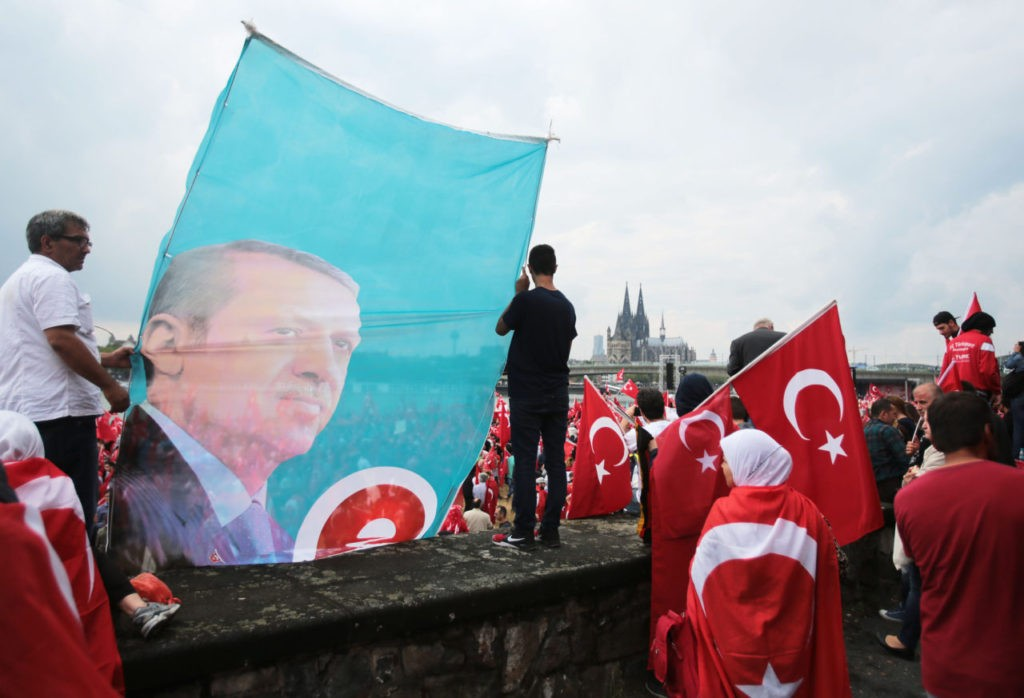 Supporters of Turkish President Recep Tayyip Erdogan attend a rally on July 31, 2016 in Cologne, as tensions over Turkey's failed coup put authorities on edge. Police said some 20,000 people had joined in the demonstration staged by groups including the pro-Erdogan Union of European-Turkish Democrats (UETD). / AFP / DPA / Oliver Berg / Germany OUT (Photo credit should read OLIVER BERG/AFP/Getty Images)