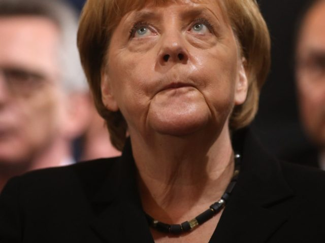 MUNICH, GERMANY - JULY 31: German chancellor Angela Merkel attends a memorial service for the victims of last week's shooting spree that left nine victims dead on July 31, 2016 in Munich, Germany. David Ali Sonboly, an 18-year-old German of Iranian descent, killed nine people in a shooting spree near …