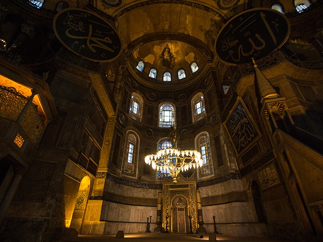 The interior of the Hagia Sophia's dome showing the Madonna and Child in the center. The Islamic panels were added centuries later after the Muslim conquest of the city. (Photo by Chris McGrath/Getty Images)