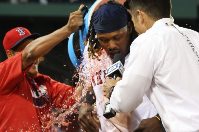 BOSTON, MA - JULY 20: Hanley Ramirez #13 of the Boston Red Sox has Powerade dumped on him after their victory over the San Francisco Giants at Fenway Park on July 20, 2016 in Boston, Massachusetts. (Photo by Adam Glanzman/Getty Images)