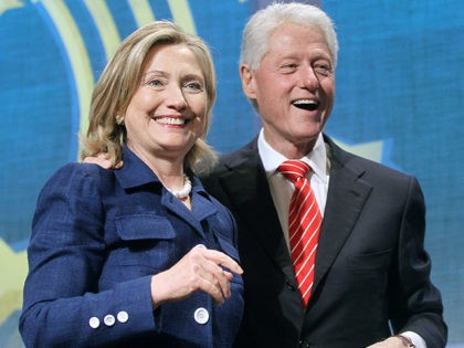 NEW YORK - SEPTEMBER 21: Former U.S. President Bill Clinton (R) and U.S. Secretary of State Hillary Rodham Clinton smile during the annual Clinton Global Initiative (CGI) September 21, 2010 in New York City. The sixth annual meeting of the CGI gathers prominent individuals in politics, business, science, academics, religion …