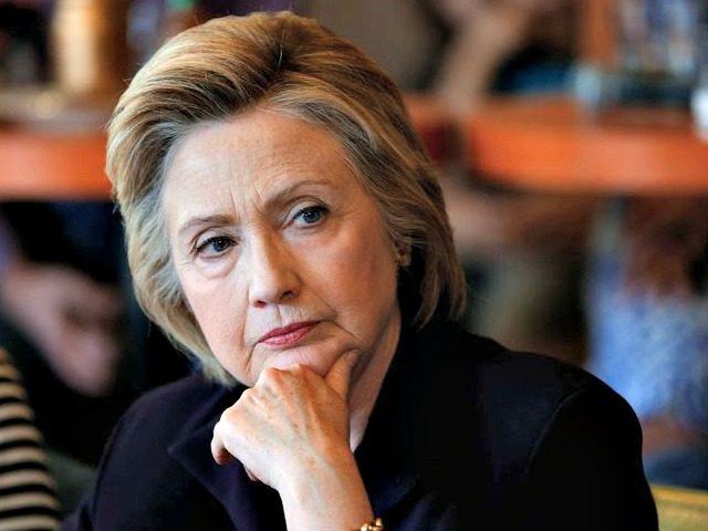 Hillary looks over APPaul Sancya