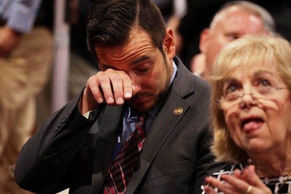 CLEVELAND, OH - JULY 18: A delegate becomes emotional while listening to the speech of Pat Smith, mother of Sean Smith, one of the four Americans killed in the September 11, 2012 terror attack on the U.S. Consulate in Benghazi, Libya, on the first day of the Republican National Convention on July 18, 2016 at the Quicken Loans Arena in Cleveland, Ohio. An estimated 50,000 people are expected in Cleveland, including hundreds of protesters and members of the media. The four-day Republican National Convention kicks off on July 18. (Photo by Chip Somodevilla/Getty Images)
