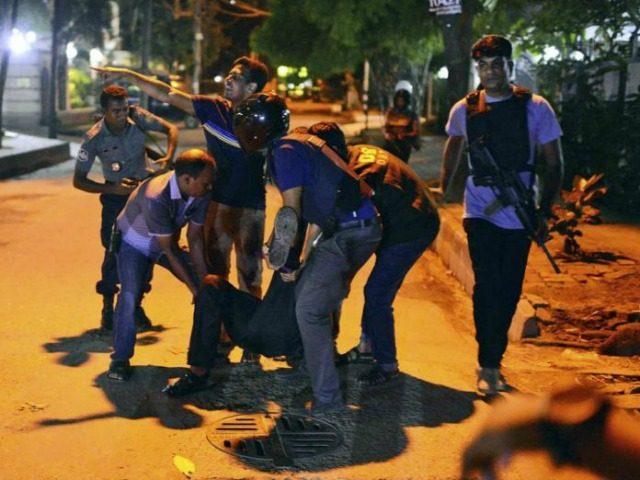 People-in-Bangladesh-help-injured-after-Dhaka-attack-ap