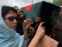 "Relatives of a Bangladeshi police officer who was killed during a bloody siege carry his coffin during a memorial service in Dhaka on July 4, 2016. Bangladesh said July 3 the attackers who slaughtered 20 hostages at a restaurant on July 1 were well-educated followers of a homegrown militant outfit who found extremism ""fashionable"", denying links to the Islamic State group. As the country held services to mourn the victims of the siege in Dhaka, details emerged of how the attackers spared the lives of Muslims while herding foreigners to their deaths.  / AFP / ROBERTO SCHMIDT        (Photo credit should read ROBERTO SCHMIDT/AFP/Getty Images)"