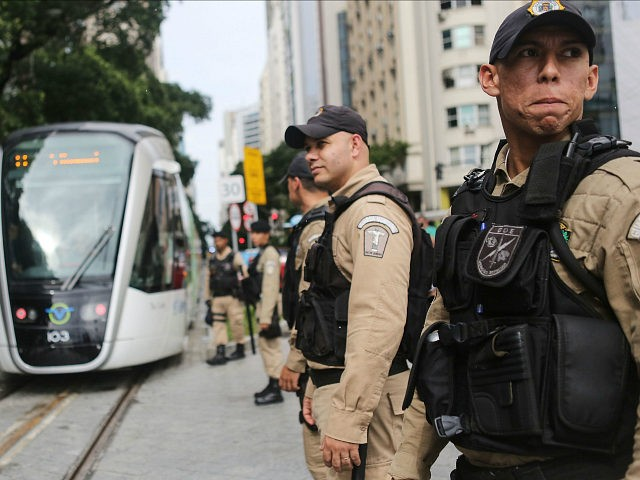 RIO DE JANEIRO, BRAZIL - JUNE 05: Police watch as a new VLT (Light Rail Vehicle) passes on the day the system was inaugurated ahead of the upcoming Rio 2016 Olympic Games on June 5, 2016 in Rio de Janeiro, Brazil. An initial section of the new system was inaugurated …