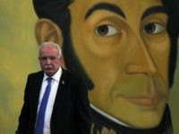 Palestinian Foreign Minister Riyad al-Maliki is seen in front of a portrait of Venezuelan Liberator Simon Bolivar in Caracas on May 19, 2015. Palestinian Foreign Minister Riyad al-Maliki said Monday in Caracas that he is willing to do 'everything that is possible' to generate a rapprochement between the governments of …