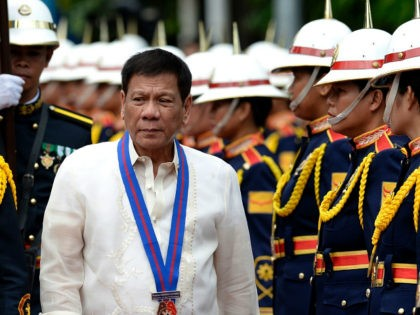 Philippine President Rodrigo Duterte walks past honour guards before Philippine National Police (PNP) chief Ronald Bato Dela Rosa's Assumption of Command Ceremony at the Camp Crame in Manila on July 1, 2016. Authoritarian firebrand Rodrigo Duterte was sworn in as the Philippines' president on June 30, after promising a ruthless …