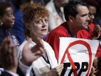 Susan Sarandon Holds Up Anti-TPP Sign on DNC Convention Floor