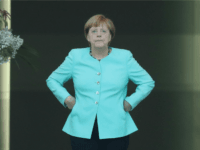Merkel Cuts Short Vacation, Returns to Face Stunned German People