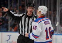 UNIONDALE, NY - NOVEMBER 15: Linesman Brian Murphy #93 penalizes Sean Avery #16 of the New York Rangers 2 minutes for unsportsmanlike conduct during the game against the New York Islanders at Nassau Veterans Memorial Coliseum on November 15, 2011 in Uniondale, New York.  (Photo by Mike Stobe/NHLI via Getty Images)
