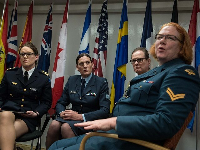 "(From L to R), transgenders Major Alexandra Larsson of the Swedish Armed Forces, Sergeant Lucy Jordan of the New Zealand Air Force and Major Donna Harding of the Royal Australian Army Nursing Corps listen to Corporal Natalie Murray of the Canadian Forces speak during a a conference entitled ""Perspectives on …"