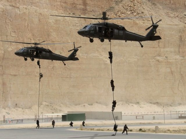 Jordanian and US special forces conduct fast-roping from a Black Hawk helicopter at the King Abdullah Special Operations Training Centre in Amman on May 27, 2012 during their 'Eager Lion' military exercise which is described as the largest exercise in the Middle East in 10 years. The exercise conducted by …