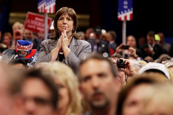 CLEVELAND, OH - JULY 18: A delegate stands as she listens to the speech of Pat Smith, mother of Sean Smith, one of the four Americans killed in the September 11, 2012 terror attack on the U.S. Consulate in Benghazi, Libya, on the first day of the Republican National Convention on July 18, 2016 at the Quicken Loans Arena in Cleveland, Ohio. An estimated 50,000 people are expected in Cleveland, including hundreds of protesters and members of the media. The four-day Republican National Convention kicks off on July 18. (Photo by Chip Somodevilla/Getty Images)