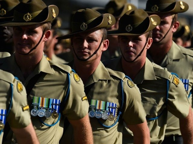 Australian soldiers from the Royal Australian Regiment march onto the parade ground at Lavarack Barracks on November 23, 2015 in Townsville, Australia. This month marks the 70th Anniversary of the formation of the 65th, 66th and 67th Battalions, later to be the 1st, 2nd and 3rd Battalions, The Royal Australian …