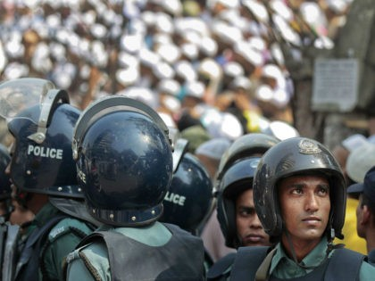 FILE - In this March 25, 2016, file photo, Bangladeshi policemen stand guard outside Bangladesh national mosque as members of various Islamic political groups and other Muslims attend Friday prayers before a protest in Dhaka, Bangladesh. The July 1, 2016 deadly attack, the worst in a wave of violence waged …